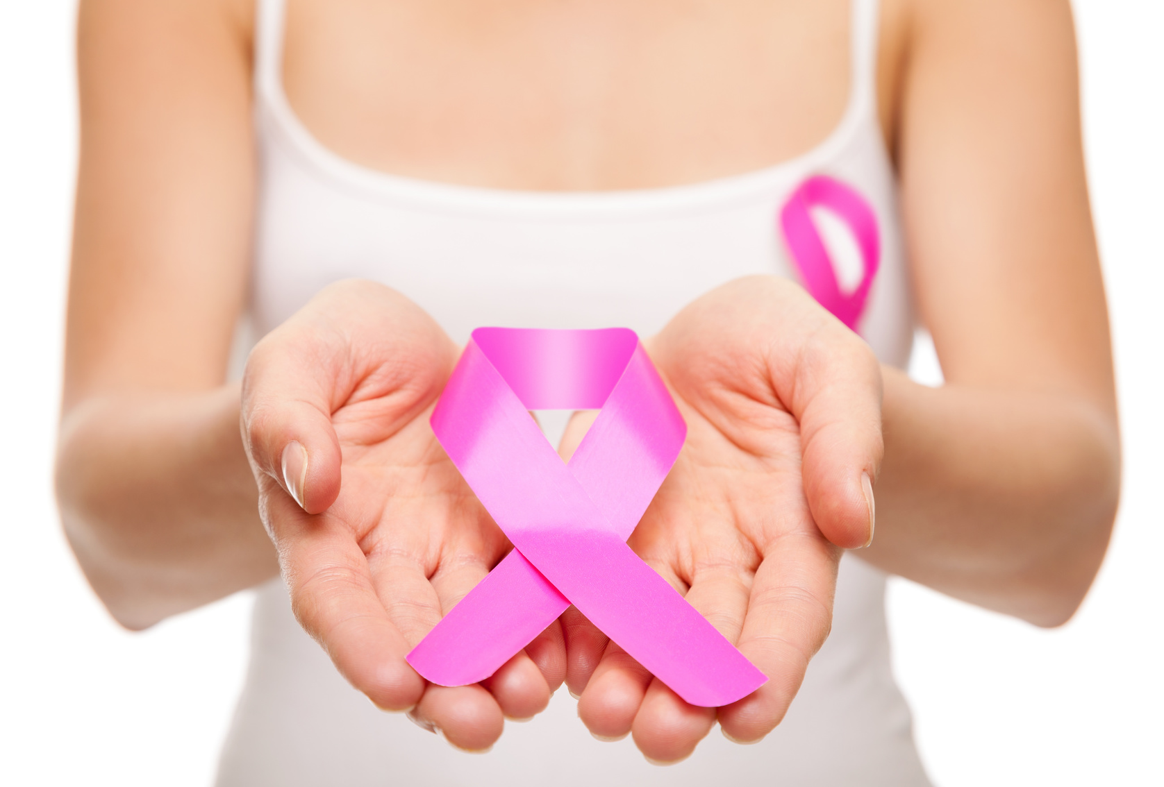 Woman holding a pink cancer awareness ribbon